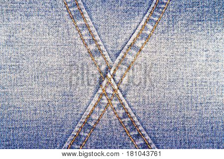 Blue jeans texture background and cross orange seam