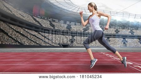 Digital composite of Side view of female athlete running on racing track