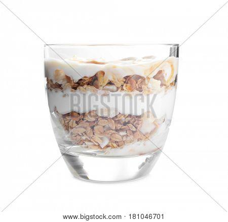 Tasty dessert with yogurt and granola in glass on white background