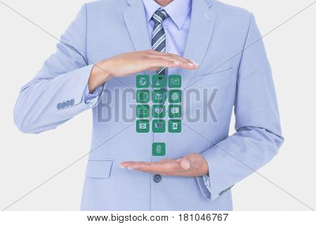 Digital composite of Digitally generated image of businessman holding various icons against white background