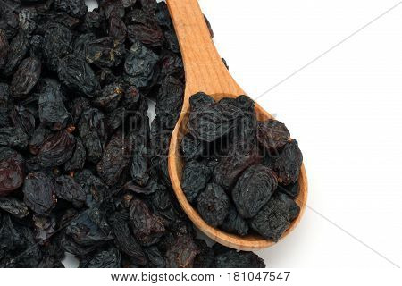 Organic dried Raisins in wood spoon isolated on white background