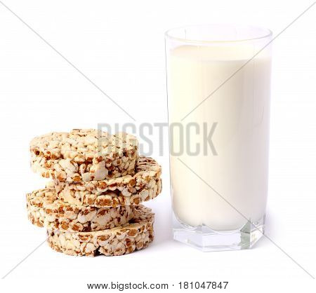 Glass of fresh milk with biscuit isolated on white background carafe