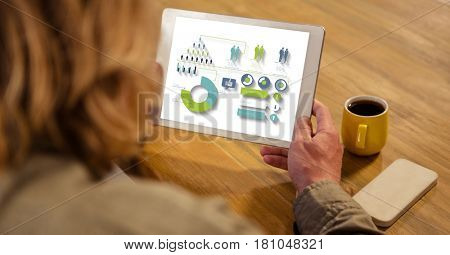 Digital composite of High angle view of businesswoman looking at graphs and chart in tablet computer while sitting by tab