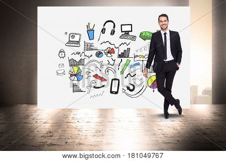 Digital composite of Portrait of businessman standing by various icons on billboard against wall