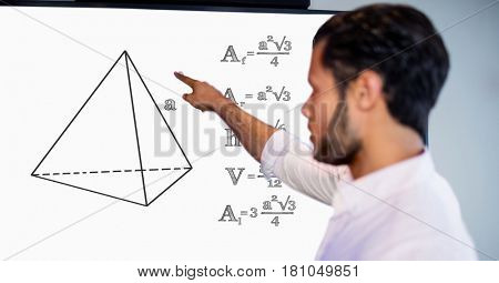 Digital composite of Man pointing over geometric shape by formulas on board