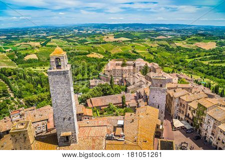 Aerial Wide-angle View Of The Historic Town Of San Gimignano With Tuscan Countryside On A Sunny Day,
