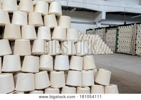 a pile of cotton yarn in the warehouse