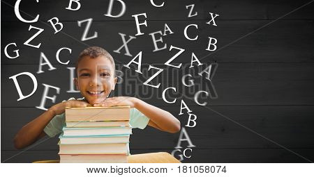 Digital composite of Digitally generated image of smiling boy holding books with letters flying in background