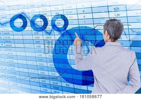 Digital composite of Rear view of executive analyzing data on screen
