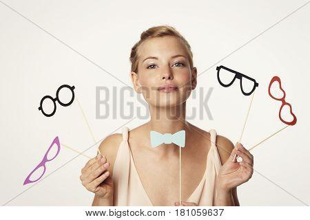 Bow tie and glasses babe in studio portrait