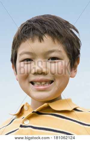 Close up of Asian boy smiling