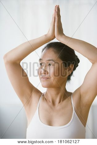 Asian woman practicing yoga