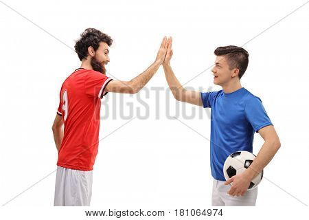 Father and son dressed in sport jerseys high fiving each other isolated on white background