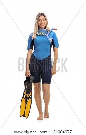 Full length portrait of a woman in a wetsuit with snorkeling equipment isolated on white background