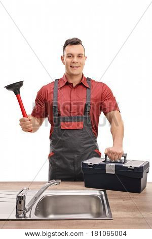 Plumber with a plunger and a toolbox standing behind a sink isolated on white background