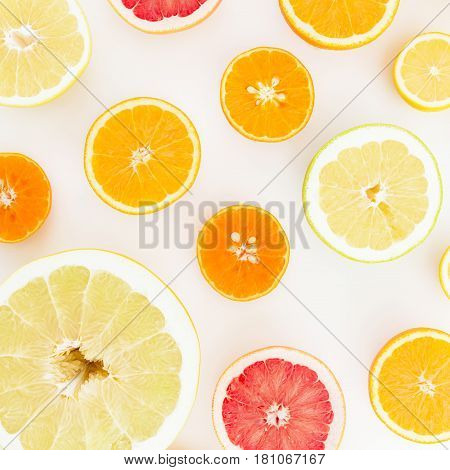 Lemon, orange, mandarin, grapefruit and sweetie on white background. Flat lay, top view. Print of fruits