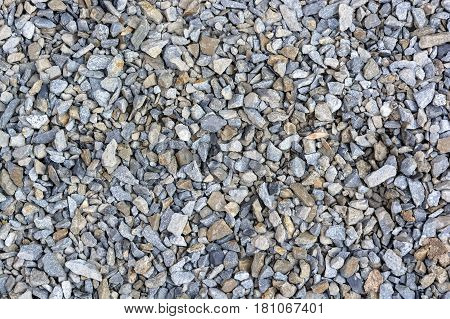 Texture of grey crushed stone gravel close up