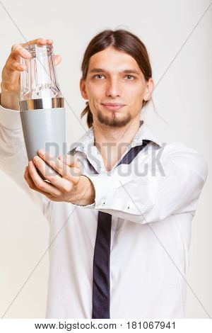 Male Barman Makes Cocktail.