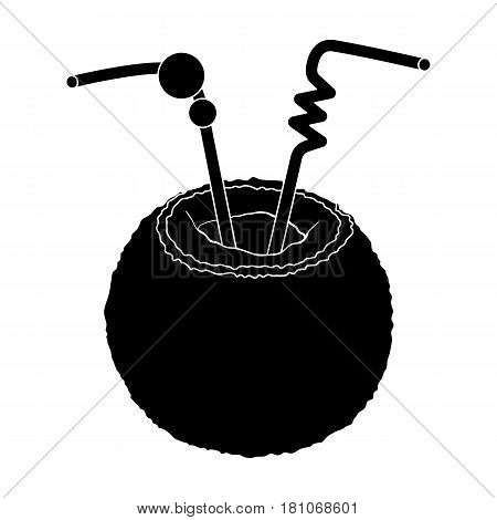 A cocktail in coconut with tubes.Summer rest single icon in black style vector symbol stock web illustration.