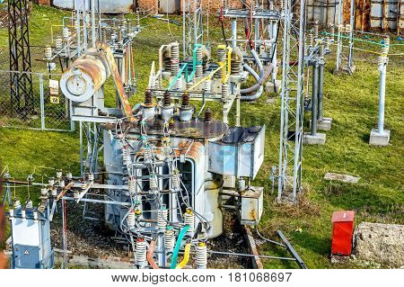 Small colorful metal power station generators on sunny day