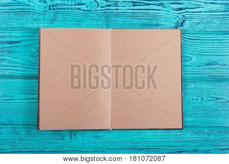 Open notebook with empty pages. Personal diary with empty pages on a blue background. A book with empty sheets. Top view. Copy space