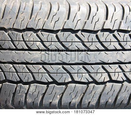 deep tread all-season tires background cars close-up