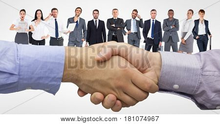 Digital composite of Digital composite image of handshake with business people in background