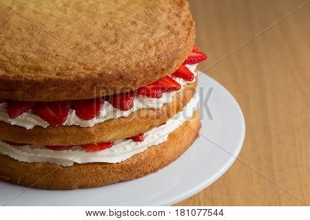 Victoria Sponge Cake with Whipped Cream and Strawberry