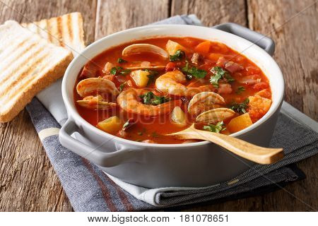 Delicious Tomato Clam Chowder Soup With Shellfish And Bacon Close-up. Horizontal
