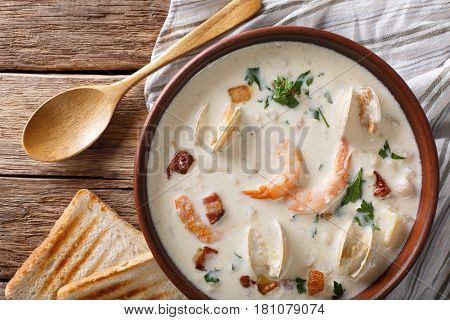 American Food: New England Clam Chowder Soup Close-up On A In A Bowl. Horizontal Top View