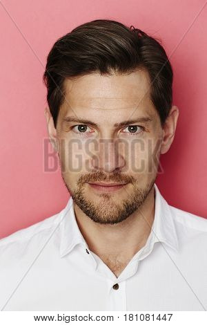 Handsome chap in pink studio portrait studio shot