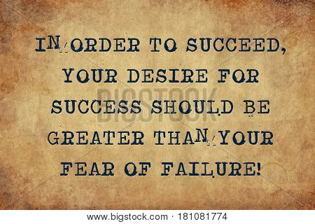 Inspiring motivation quote of in order to succeed your desire for success should be greater than your fear of failure with typewriter text. Distressed Old Paper with Typing image.