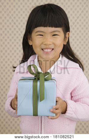 Young Korean girl holding present