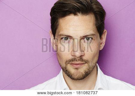 Portrait of handsome man with stubble studio