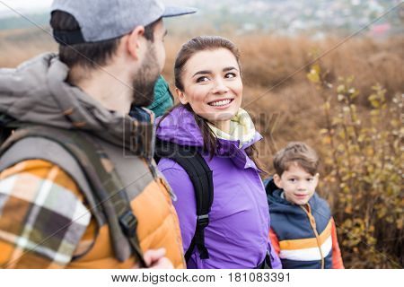 Happy Family With Backpacks