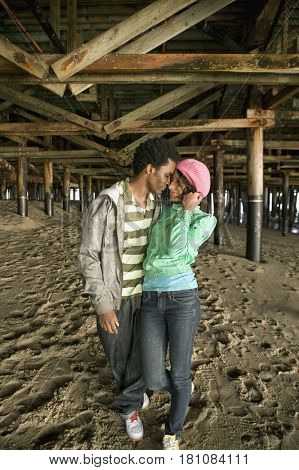 African couple walking underneath boardwalk