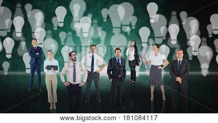 Digital composite of Digital composite image of business people over light bulb background