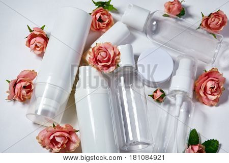 Cosmetic Bottles. Wellness And Spa Bottles Collection With Spring Parfume Flowers. Beauty Treatment,