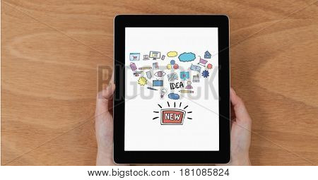 Digital composite of Hands holding digital tablet with new idea icons