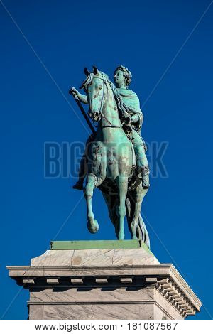 COPENHAGEN DENMARK - MARCH 11 2017: Equestrian statue of Frederick V in front of Frederiksstad Amalienborg Palace home of Danish royal residence.