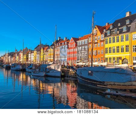 COPENHAGEN DENMARK - MARCH 11 2017: Copenhagen Nyhavn district. Nyhavn was constructed by King Christian V from 1670 to 1673 dug by Swedish prisoners of war from the Dano-Swedish War 1658-1860