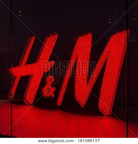 MALMO SWEDEN - MARCH 08 2017: H&M logo in department store window in Malmo's Emporia Shopping Center the largest shopping mall in Scandinavia.