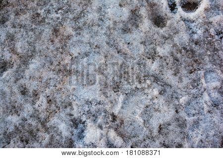 Dirty gray snow. Unusual background.Slush and dirt