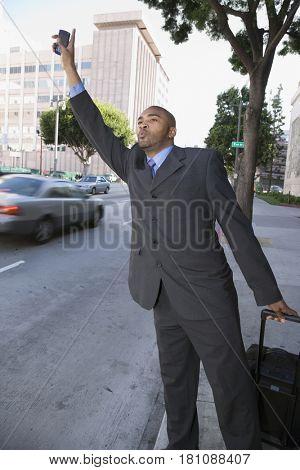 African businessman hailing a taxi