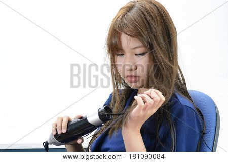 Hair Care. Woman Drying Beautiful Long Straight Hair Using Dryer. Portrait Of Attractive Girl Model With brunette Hair Using Hairdryer Round Brush For Hairdressing. Hairstyle Concept.