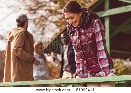 Smiling Young Woman Leaning On Railing