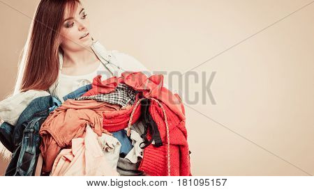 Side View Young Woman Hold Pile Of Clothes.