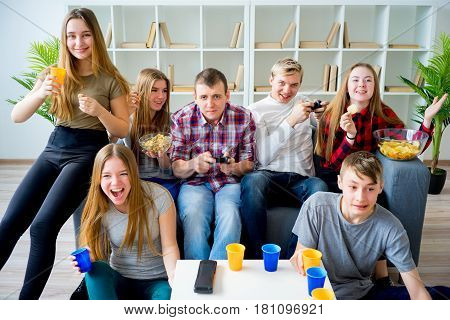 Group of friends playing a console game