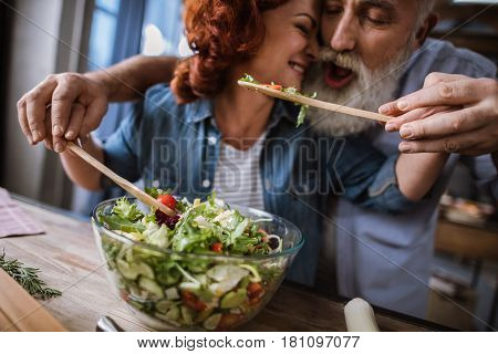Couple Cooking Vegetable Salad