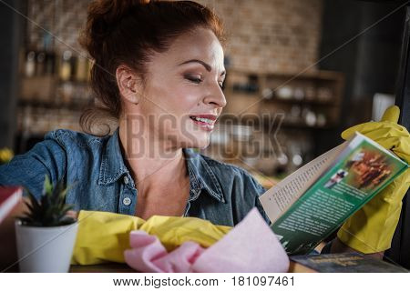 Woman Cleaning Bookshelf